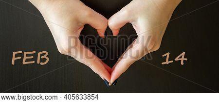 February 14 Valentines Day Symbol. Woman Making Heart Shape On Dark Background. Words Feb 14. Heart