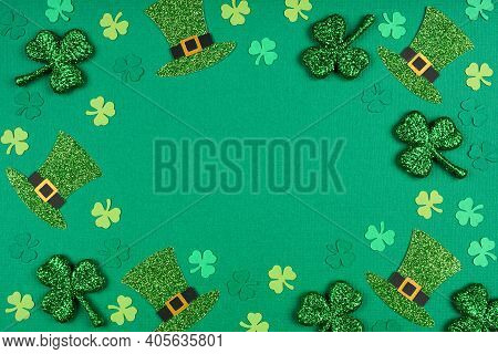 St Patricks Day Shamrock And Leprechaun Hat Frame. Above View Over A Green Paper Background With Cop