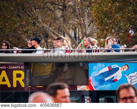 Paris, France - Oct 13, 2018: Parisian Evening With International Tourists On The Sightseeing Bus Ta