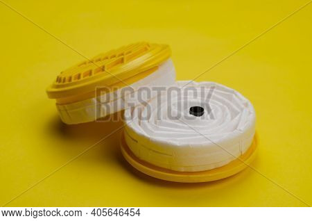 New Replacement Filters For Industrial Respirator On Yellow Background. Personal Respiratory Protect