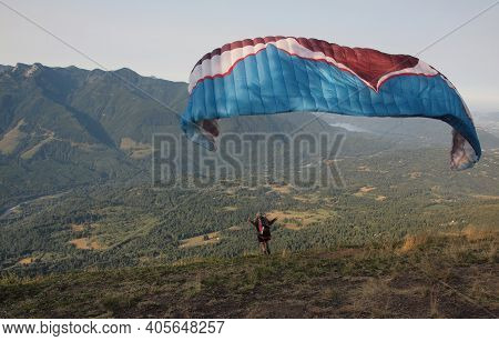 Chilliwack, British Columbia, Canada, 08-02-2015. Para Glider Launching From Mount Elk In British Co