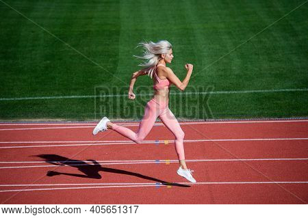 Woman In Motion. Athletic Lady Compete In Sprint. Sport Healthy Lifestyle. Fitness Training Outdoor