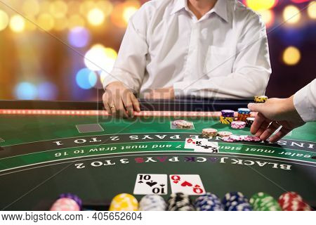 Man playing BlackJack at the casino - Shallow depth of field