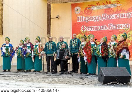 Chelyabinsk, Russia, March 2, 2014. Russian national holiday of farewell to winter. Slavic holiday Maslenitsa. Russian folk choir performs on the open-air stage.