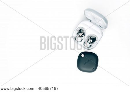 Kiev, Ukraine - January 29, 2021: New Headphones Samsung Buds Pro With Tracker Smarttag On White Bac
