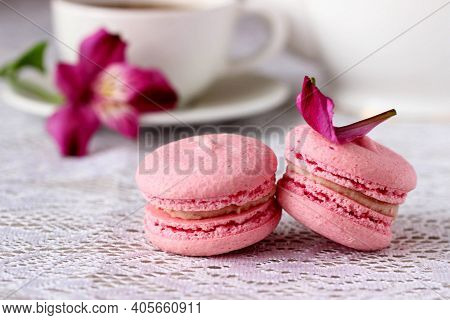 Pink Macaroon (macaron) Closeup On White Table Background. Sweet Tasty Strawberry Macaroon And Cup O