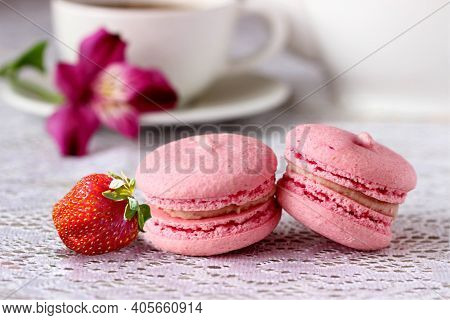 Strawberry Macaroon (macaron) Closeup On White Table Background. Sweet Tasty Pink Macaroon And Cup O