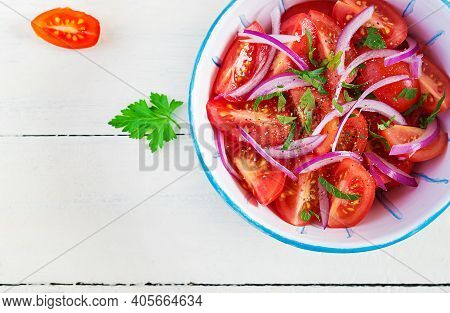 Fresh Tomatoes With Red Onion And Spices In A Blue Bowl.  Concept Healthy Appetizer. White Wooden Ba