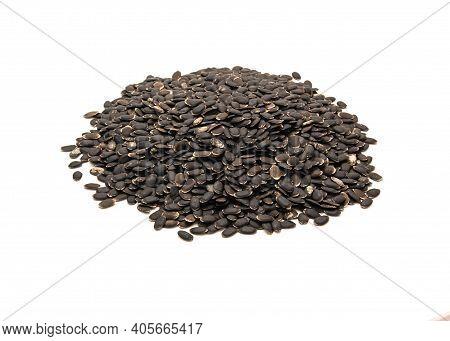 Studio Shot Pile Of Luffa Or Loofah, Luffa Aegyptiaca Seeds Isolated On White Background