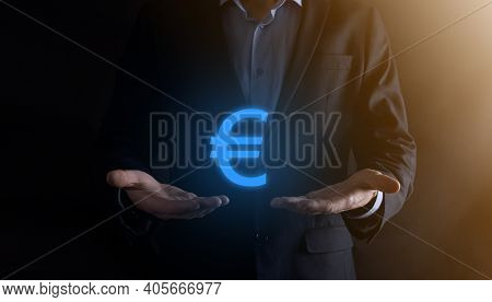 Businessman Holds Money Coin Icons Eur Or Euro On Dark Tone Background..growing Money Concept For Bu