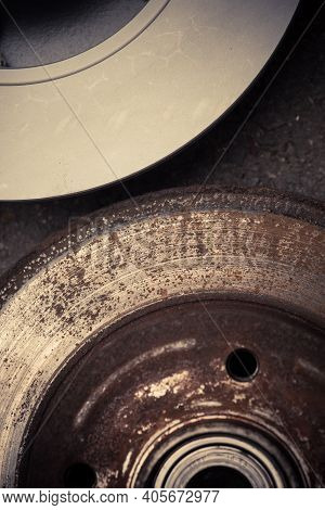 Close Up Shot Of A Car Worn And Rusty Brake Disk And A New One.