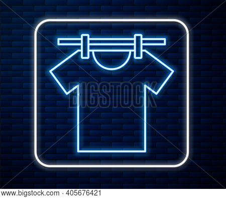 Glowing Neon Line Drying Clothes Icon Isolated On Brick Wall Background. Clean Shirt. Wash Clothes O