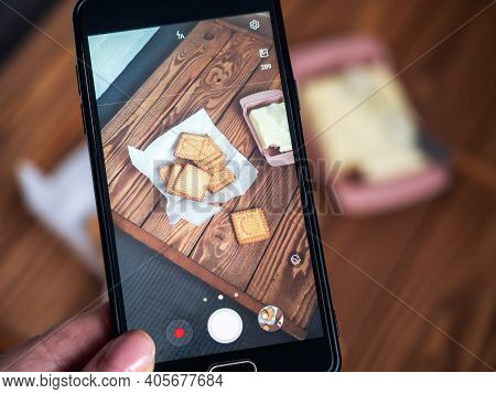 The Process Of Taking Food Photography On The Phone By A Food Blogger. Mobile Phone With Food Photo