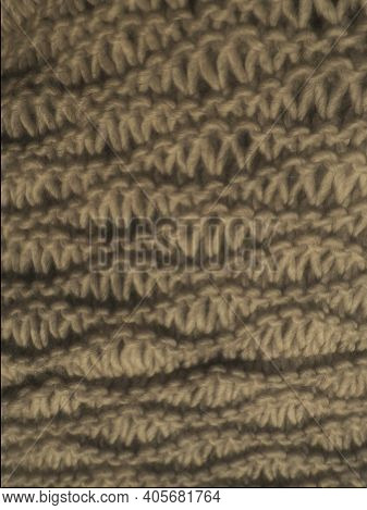 Knitted Pattern Of Brown Or Beige Yarn. Lush Machine Or Hand Knitting. Warm Wardrobe For The Autumn-