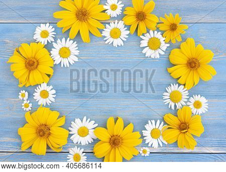 Frame Of Beautiful Summer Flowers Of Daisies And Chrysanthemums On A Blue Or Azure Shabby Wood Backg