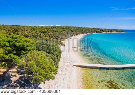 Beautiful Beach On Pag Island, Adriatic Sea In Croatia. Pine Woods And Long Sand Beach With Pier. Po