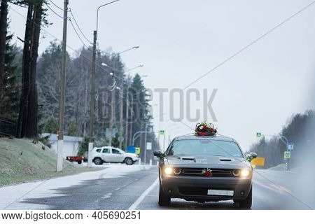 The Car Is Driving On A Winter Snow-covered Highway, Bad Weather Conditions And Slippery Asphalt Req