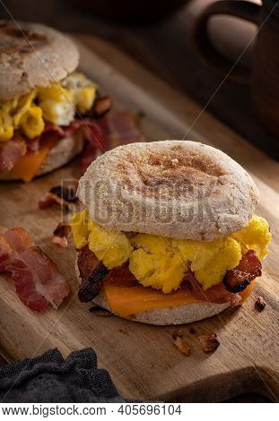 Breakfast Sandwich With Scrambled Eggs, Bacon And Cheese On An English Muffin