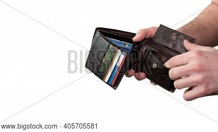 A Man With A Wallet In His Hands, Credit Cards In A Wallet Is Isolated On A White Background, A Man