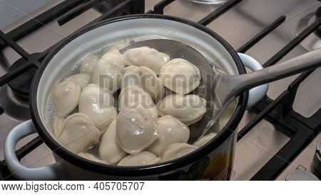 Cook Dumplings In A Saucepan, Homemade Dumplings. Stir The Dumplings With A Scoop.
