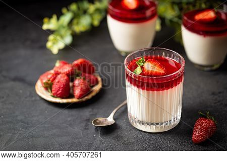 Italian Panna Cotta Dessert With Strawberry Sirup And Mint Leaf