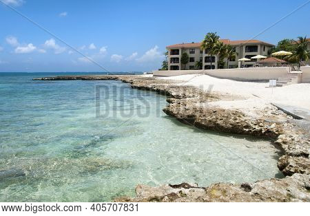 The Rocky Eroded Coastline Of Seven Mile Beach On Grand Cayman Island (cayman Islands).