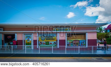 Grand Cayman, Cayman Islands, July 2020, View Of The Colorful Building Of People's Choice Grocery St