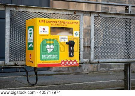 Stirling, Scotland - August 13, 2019: Life Saving Defibrillator (heart Restarter) Yellow Rescue Box