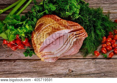 Hickory Smoked Spiral Sliced Ham With Fresh Vegetables. Holiday Food.
