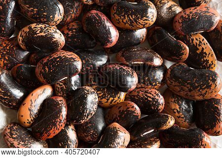Red And Black Spotted Beans Close-up. The Pattern Of The Haricot, Background, Texture. A Healthy Die