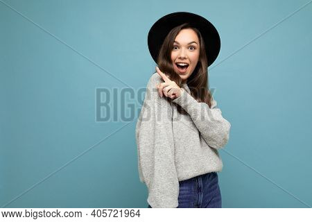 Photo Of Attractive Brunette Happy Joyful Young Woman Pointing Finger At Free Space For Text Wearing
