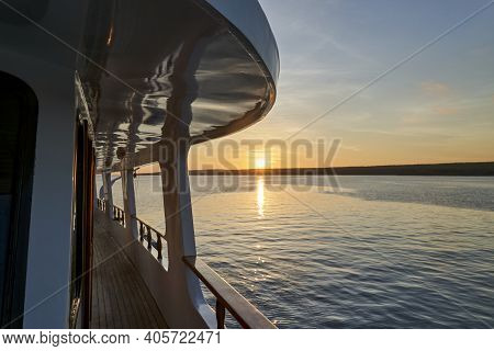 Beautiful And Spectacular Sunset Over A Motor Yacht With Reflections On The White Paint And Details