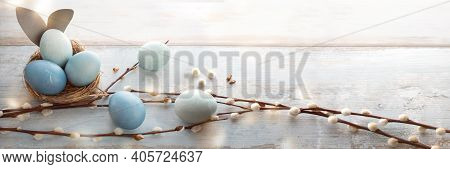 Tender Blue Easter Eggs Decorated With Pussy Willow On Gray Vintage Planks. Horizontal Spring Backgr