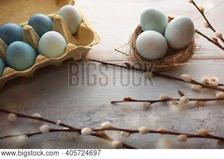 Tender Blue Easter Eggs Decorated With Pussy Willow On Gray Vintage Planks. Spring Background For Ea