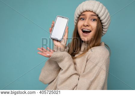 Closeup Photo Of Amazed Beautiful Positive Good Looking Young Woman Wearing Stylish Beige Sweater An