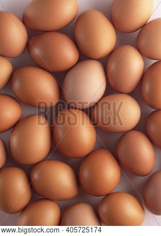 Brown Fresh Chicken Eggs In Carton . Closeup Natural Organic Egg Pattern. Healthy Real Food. Top Vie