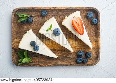 New York Cheesecake Or Classic Cheesecake With Fresh Berrie, On White Background, Top View Flat Lay