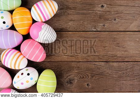 Colorful Easter Egg Side Border. Overhead View Against A Rustic Wood Background. Copy Space.