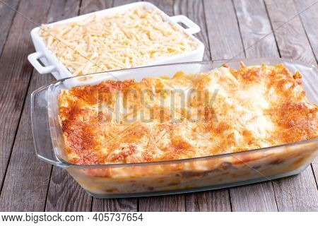 Lasagne Or Casserole On A Wooden Table. Ready Dish