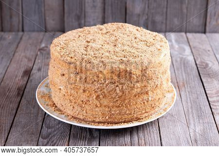 Layer Honey Cake Medovik On A Wooden Table. Traditional Layer Sponge Cake With Honey Cream