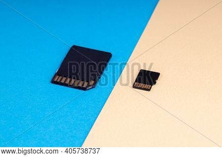 Sd And Micro Sd Memory Card On Blue And Yellow Background. Different Kind Of Portable Storage Device