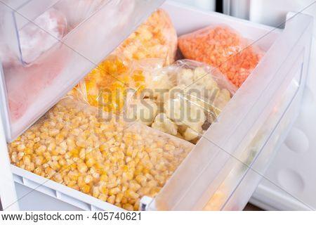 Frozen Vegetables In The Freezer. Frozen Corn, Cauliflower, Peppers. Frozen Food