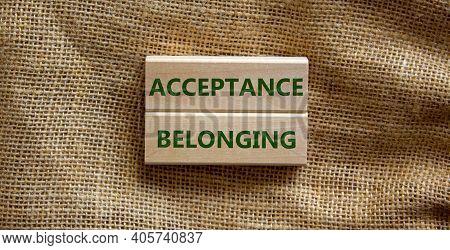 Acceptance And Belonging Symbol. Wooden Blocks With Words 'acceptance And Belonging' On Beautiful Ca