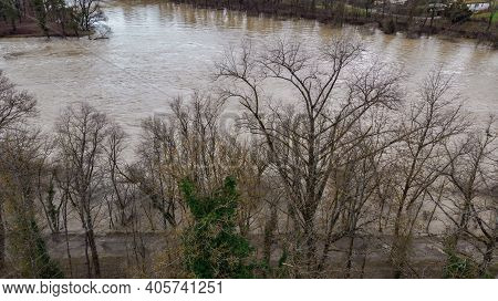 Aerial View From High Level Water. The Channel Of Aare In Riverside Forest Near Weir Is Overflowed W