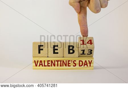 February 14 Valentines Day Symbol. Hand Turns A Wooden Cube. Words 'feb 14 Valentines Day'. Beautifu