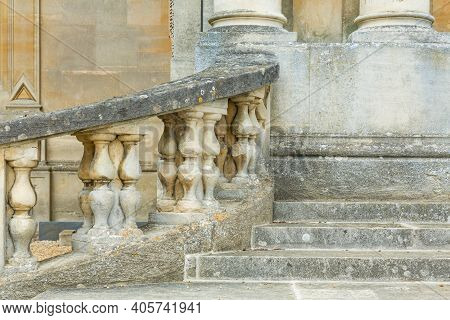 Stone Steps And Balustrade With Columns Outside An Ancient Manor House, Uk