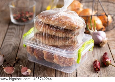 Frozen Cutlets In A Container. Ready Frozen Food. Fast Cooking Concept. Semi Finished Frozen Cutlets