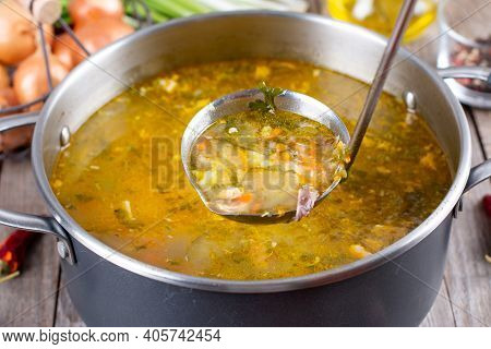 Russian Soup Rassolnik, Soup With Pickled Cucmbers, Pearl Barley In A Saucepan