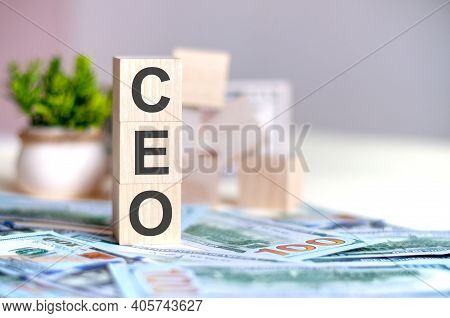Dollars Banknote With Calculator And Word Ceo. Banknotes And Wooden Cubes With Letters Ceo. Concept