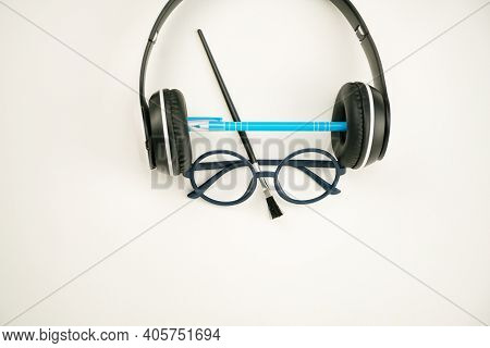 Education Concept Of Equipment Accessory Teacher Face On White Paper Background.